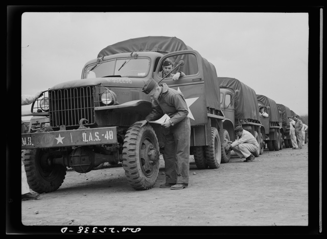 Holabird ordnance depot, Baltimore, Maryland. Before the departure of a truck convoy, drivers must give all vehicles a thorough checkup, including inspection of tires for uneven wear. A badly or spottily worn tire will be sent to the depot's recapping shop