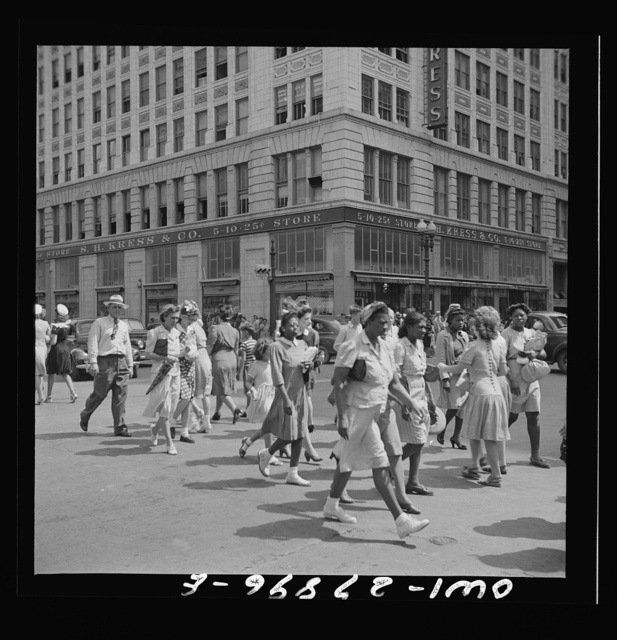 Houston, Texas. People crossing a downtown street with the green light