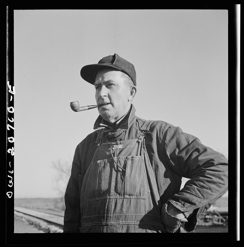 Iden, New Mexico. A.E. Janes, foreman of a section crew working on the track in the Atchison, Topeka and Santa Fe Railroad yard