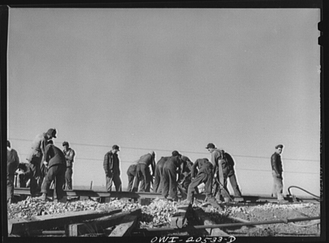 Iden, New Mexico. Atchison, Topeka and Santa Fe Railroad section gang working on a track