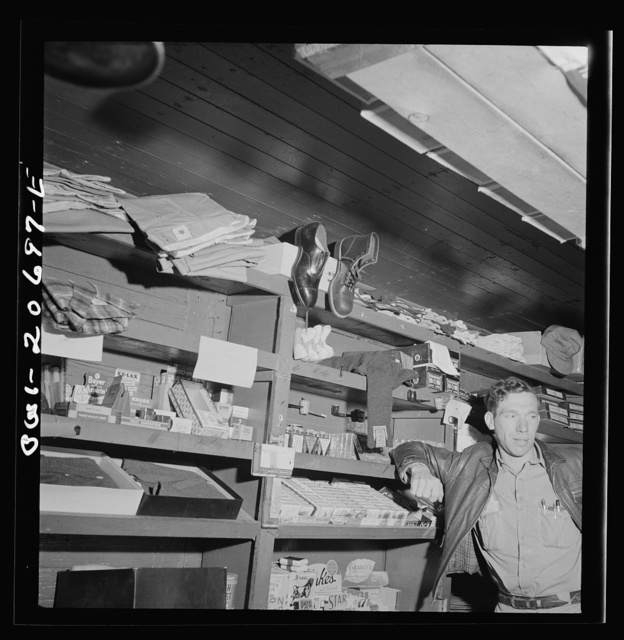 Iden, New Mexico. In the commissary car of a work train on the Atchison, Topeka and Santa Fe Railroads. The clerk is J.E. Straight of Newton, Kansas