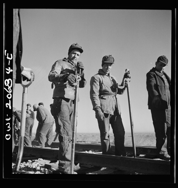 Iden, New Mexico. Jacob Chaves of Torion, New Mexico, left, and Louis Bocca of Willard, New Mexico. Section workers on a job in the Atchison, Topeka and Santa Fe Railroad yard between Clovis and Vaughn, New Mexico