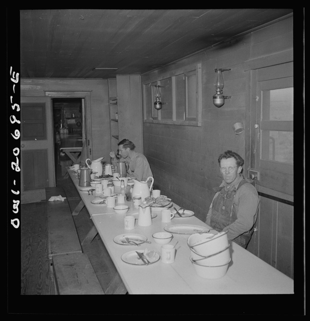 Iden, New Mexico. The last few workers have breakfast in the dining car of work train on the Atchison, Topeka and Santa Fe yard, between Clovis and Vaughn, New Mexico