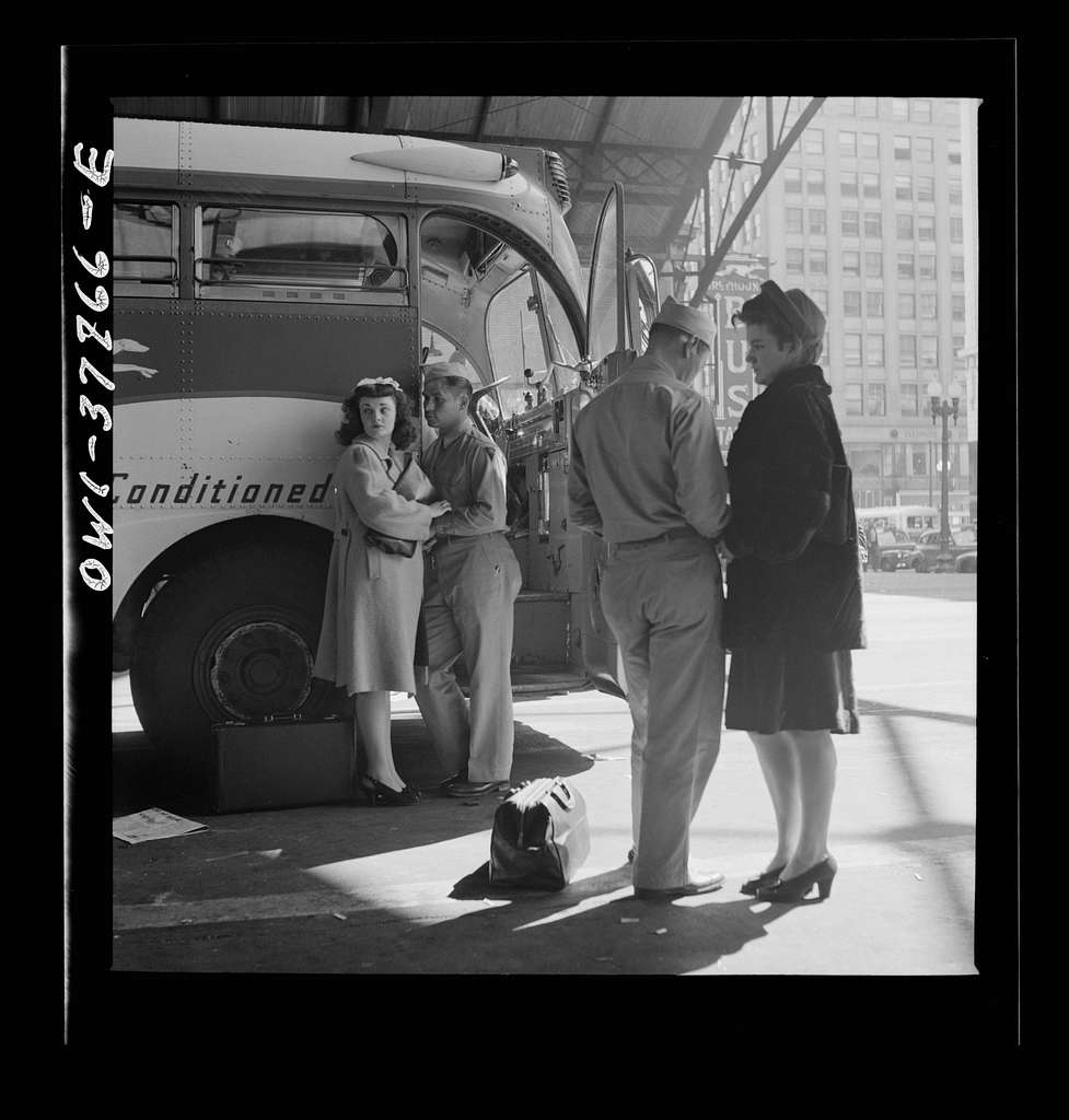 Indianapolis, Indiana. A soldier and a girl saying goodbye at the Greyhound bus station