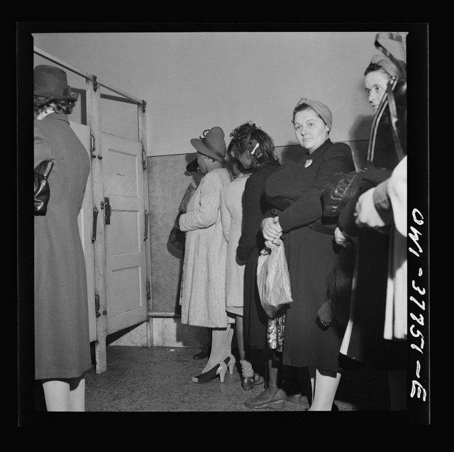 Indianapolis, Indiana. Bus passengers waiting in line to use the free toilet in the ladies' restroom at the Greyhound bus terminal