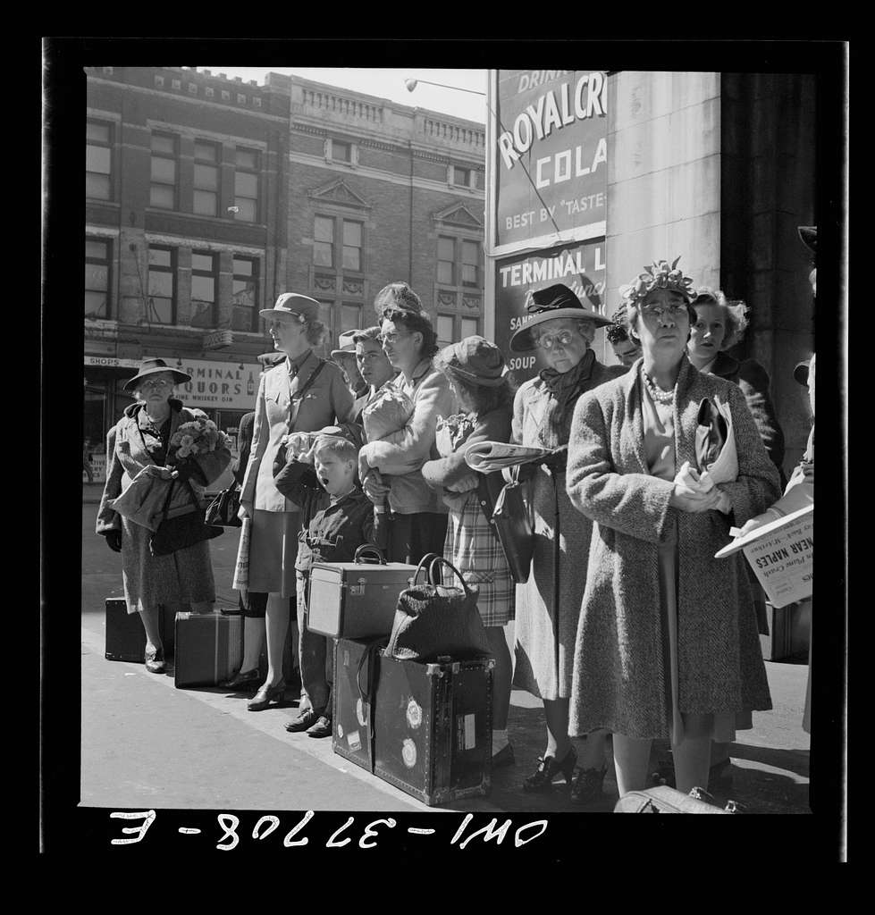 Indianapolis, Indiana. People waiting for a Greyhound bus bound for Louisville, Kentucky