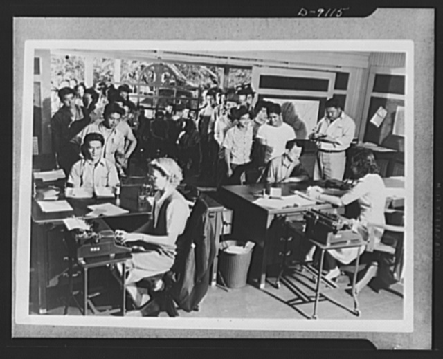 Japanese enlistment. A group of 110 men from the village of Aiea, Territory of Hawaii crowd into Selective Service Board No. 9 in Waipahu. They are waiting to sign applications for voluntary induction into the U.S. Army's recently formed combat regiment composed of 1,500 American citizens of Japanese ancestry