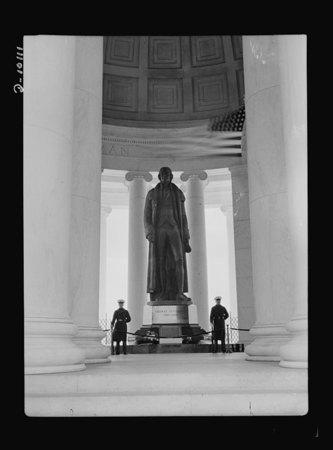 Jefferson Memorial. Within the Jefferson Memorial rotunda in Washington, D.C., stands this nineteen-foot statue of America's third president. A Marine Honor Guard stands watch at its base where the original Declaration of Independence has been placed to commemorate Jefferson's bi-centennial anniversary, April 12, 1943. The The plaster of paris statue, made by a sculptor Rudolph Evans, will be cast in bronze after the war
