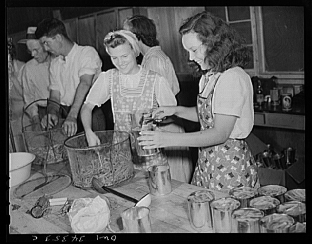Jeffersontown, Kentucky. The Jefferson County ommunity cannery, started by the WPA (Work Projects Administration), now conducted by the state (?) vocational education department. Women pay three cents each for cans and two cents per can for use of the pressure cooker. Girls canning some of the beans raised in their victory gardens