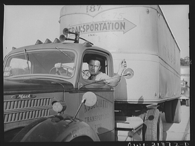 Jim Bishop waving to a passing truck driver on U.S. Highway 29 in Georgia