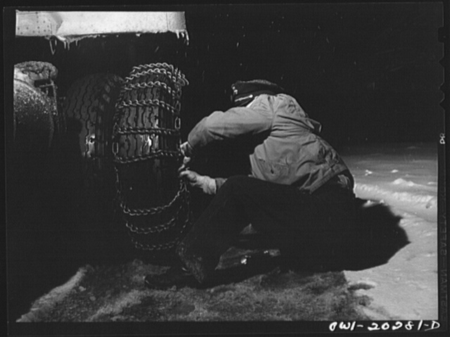 Jim Fletcher stopping to put on chains while crossing the Blue Ridge Mountains in Tennessee during a snow storm