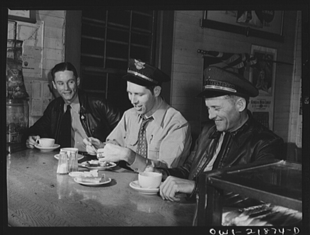 John Phillips (right) with other truck drivers at a midnight coffee stop on U.S. Highway 29 enroute to Mobile, Alabama