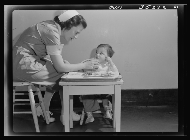 Johns Hopkins Hospital, Baltimore, Maryland. A student nurse feeding a convalescent youngster