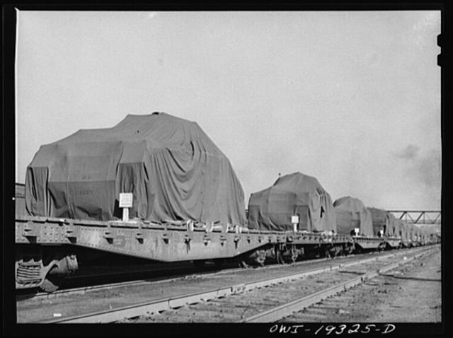 Kansas City, Kansas. Military tanks on their way through the Atchison, Topeka and Santa Fe Railroad yard