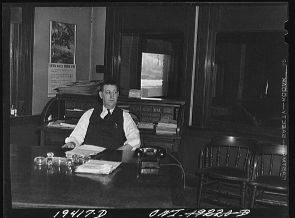 Kansas City, Missouri. R. G. Gross of the Atchison, Topeka and Santa Fe Railway, freight agent, in his office at the freight depot
