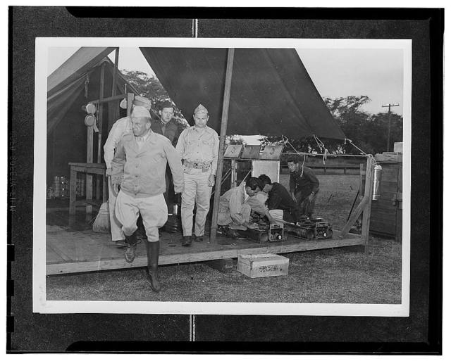 Kauai District, Territory of Hawaii. Major General Rapp Brush leaving the kitchen tent to continue his inspection of the provisional camp for AJA inductees