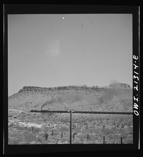 Kingman (vicinity), Arizona. A double-header eastbound passenger train on the Atchison, Topeka and Santa Fe Railroad between Seligman, Arizona and Needles, California, climbing a mountain
