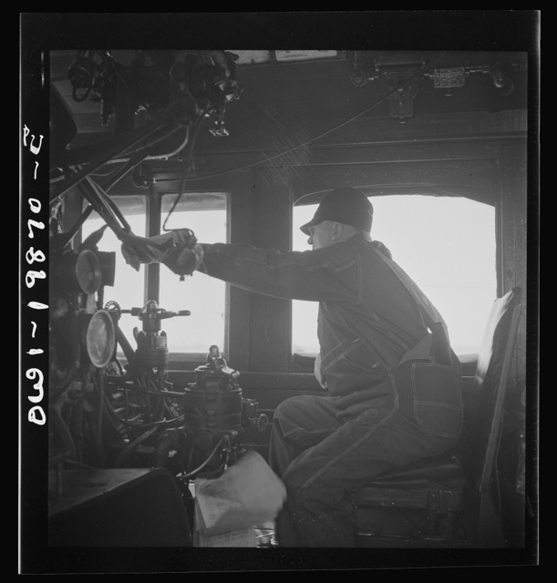 Kiowa, Kansas. Engineer B. F. Hale in the cab of his engine on the Atchison, Topeka, and Santa Fe Railroad between Wellington, Kansas and Waynoka, Oklahoma