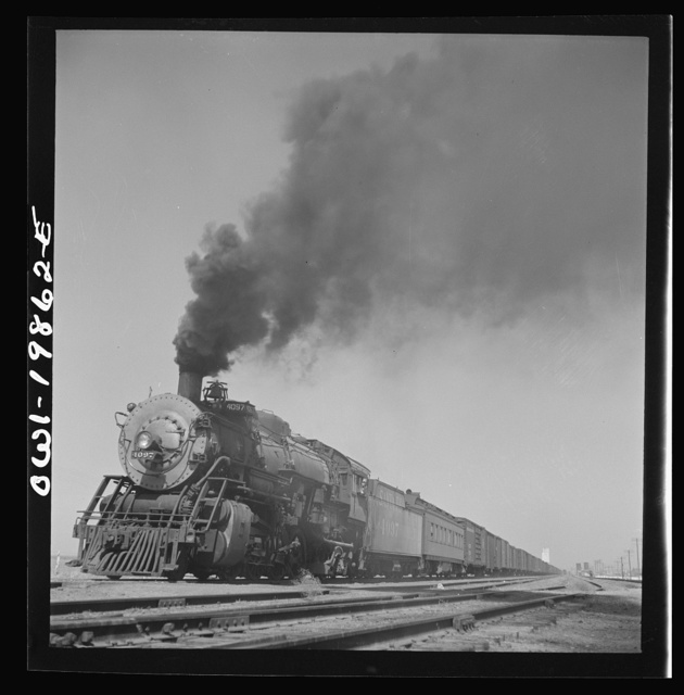 Kiowa, Kansas. Freight train pulling out on the Atchison, Topeka and Santa Fe Railroad between Wellington, Kansas and Waynoka, Oklahoma