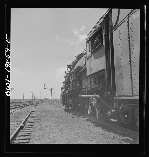 Kiowa, Kansas. Train waiting for a block signal along the Atchison, Topeka and Santa Fe Railroad between Wellington, Kansas and Waynoka, Oklahoma