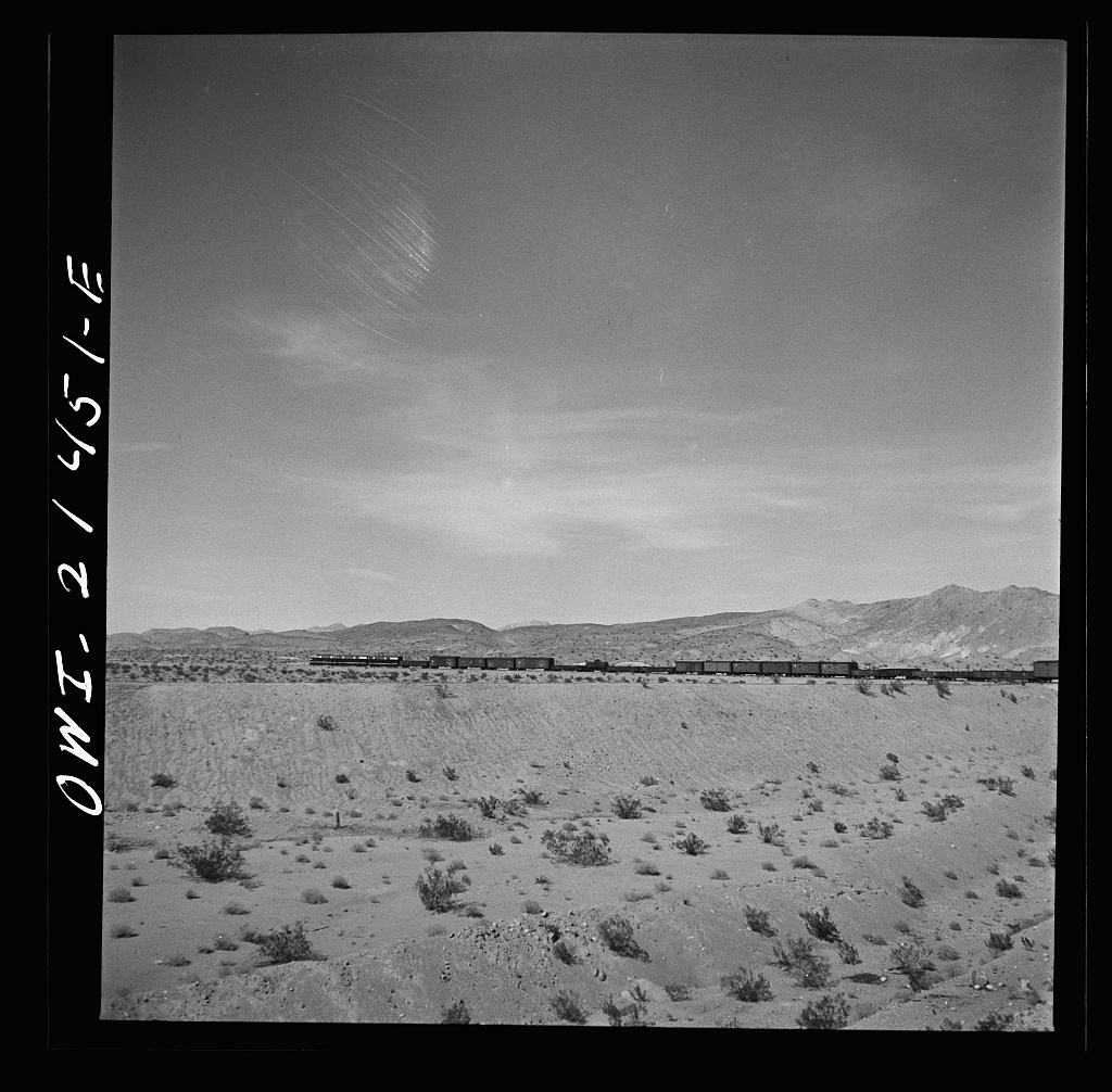 Klondike (vicinity), California. Going around a curve on the Atchison, Topeka and Santa Fe Railroad between Needles and Barstow, California
