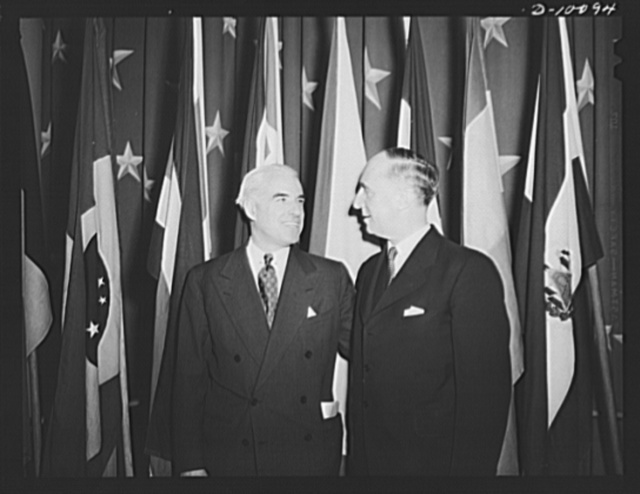 Lend-lease administrator Edward R. Stettinius, Jr., and the Norwegian ambassador Wilhelm Munthe de Morgenstierne, at luncheon held in observance of second anniversary of lend-lease, on March 11, 1943, at the Hotel Statler, Washington, D.C.