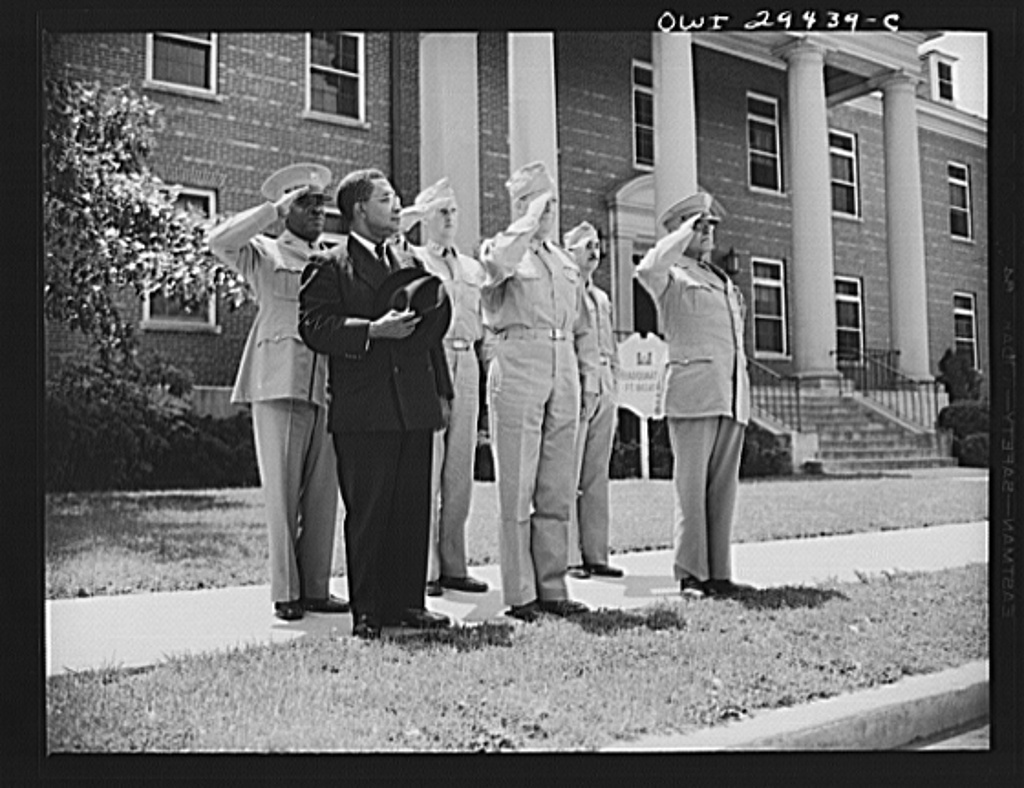 "Liberian presidential party visits Fort Belvoir. Two twenty-one gun salutes, a regimental review and a luncheon with the commanding officers were tendered His Excellency, Edwin Barclay, President of the Republic of Liberia, when he visited Fort Belvoir, Virginia, on May 29, 1943. President Barclay is shown with members of his party and fort officers as the regimental band played the Liberian national anthem ""All Hail, Liberia Hail."" Brigadier General Edwin H. Marks, commanding officer of the fort, and Brigadier General Benjamin O. Davis, U.S.A. military aide to President Barclay are shown in the front row with His Excellency. Captain Alford Russ of the Liberian Fontier Force and Captain Swann of Fort Belvoir's public relation office are shown in the rear"