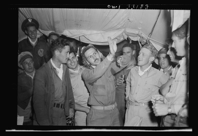 Lieutenant McArthur Powers, twenty-seven, of Inwood, New York, (left) and Lieutenant Richard E. Duffey, twenty-four, of Walled Lake, Michigan, at the 57th Fighter Group base somewhere in Tunisia after both men had become aces in a single engagement by destroying five enemy planes. Powers, who had been with the Royal Air Force at El Alamein, now has seven enemy planes to his credit. He had two with the Royal Air Force