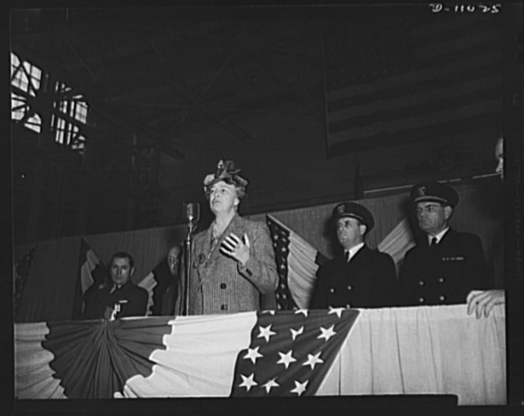 Linden, New Jersey. Mrs. E.D. Roosevelt during her visit to General Motor's Eastern Aircraft Division. Left to right:  L.H. Savage, president of Industrial Food Crafts Inc.; C.S. Swayze, manager, Linden plant, General Motors, Inc.; Mrs. Eleanor Roosevelt; Lieutenant W.H. Hewitt, U.S. Navy, Inspector of Aircraft; and Lieutenant S. Noel, Public Relations, U.S. Navy