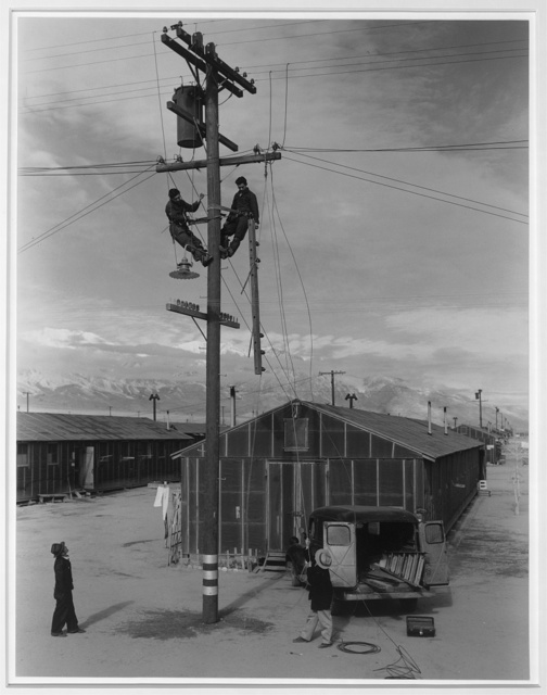 Line crew at work in Manzanar, Manzanar Relocation Center, Manzanar, California / photograph by Ansel Adams.