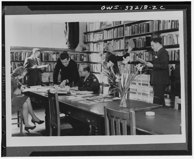 London, England. Civilians and the military both make good use of the facilities of the United States Office of War Information's (OWI) newly opened special reference library in connection with the American Embassy
