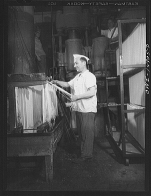 Long Island City, New York. Atlantic Macaroni Company, makers of Caruso brand products. Workers hanging out spaghetti to dry