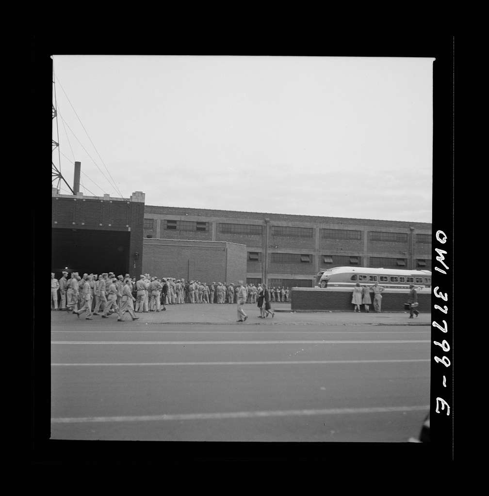 Louisville, Kentucky. Part of a line of soldiers waiting for Fort Knox bus at the Greyhound bus station