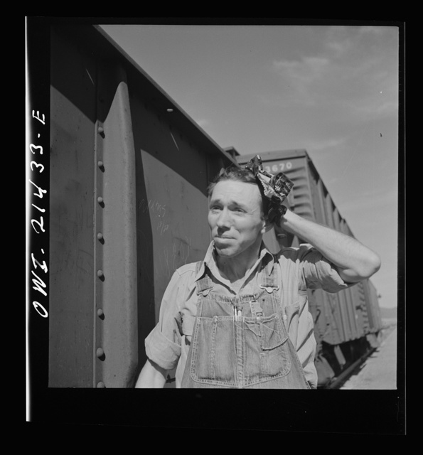 Ludlow, California. Conductor W.C. Scott in the Atchison, Topeka, and Santa Fe Railroad yards. His home is in Needles, California