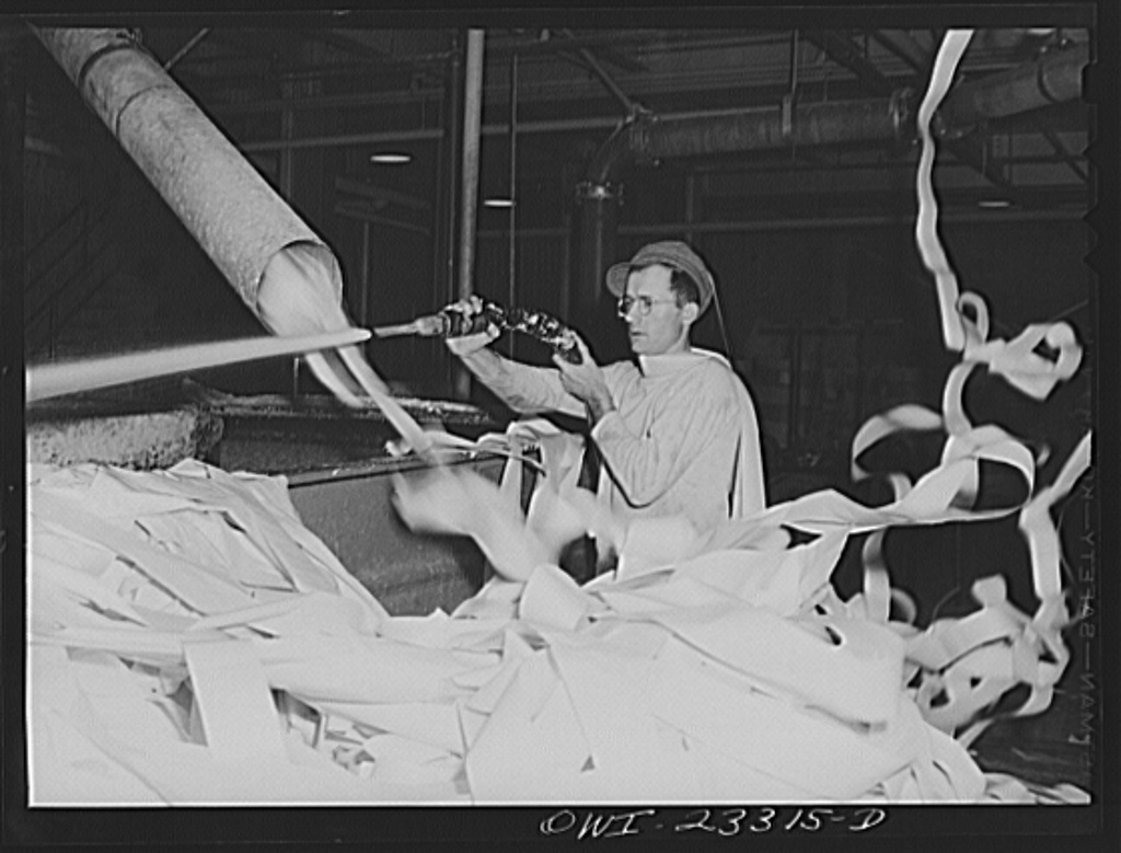 Lufkin, Texas. Southland paper mill. Waste paper from the trimmed edges of newsprint rolls blows down to the basement to a vat where it is converted back into pulp