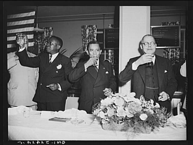 Luncheon for Liberian Presidential party. His Excellency, Edwin Barclay, President of the Republic of Liberia, was feted by Negro civic, social, professional and educational leaders Saturday, May 29, 1943 at a luncheon at the Lucy Diggs Slowe Hall in Washington, D.C. President-elect W.V.S. Tubman, President Barclay and Dr. Emmet J. Scott, chairman of the committee on invitation are shown drinking a toast to the President of the United States. The toast was proposed by the President of Liberia