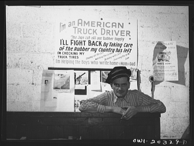 Lynchburg, Virginia. A truck driver at the terminal, waiting to go out