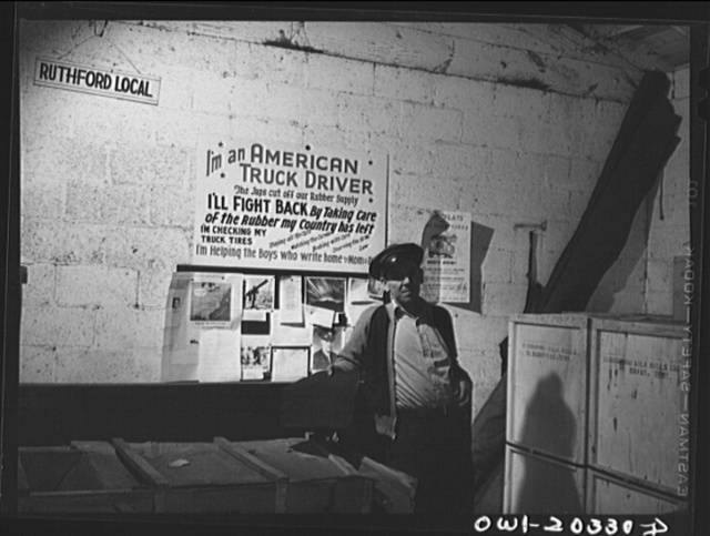 Lynchburg, Virginia. Noah Booher driver for the Associated Transport Company truck terminal just before starting his run to Bristol, Tennessee