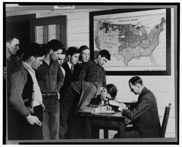 Madison, Wisconsin. Farm short course school at the University of Wisconsin. Mr. William Stemmler, school counselor, distributing allowance checks (four dollars per two weeks) to the students