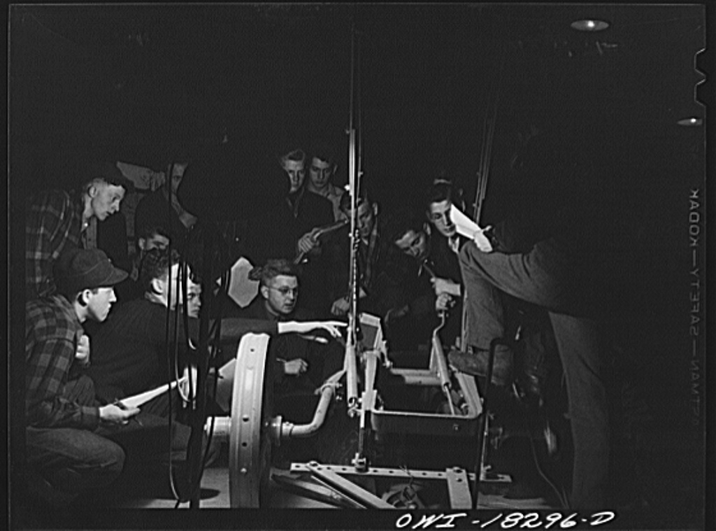 Madison, Wisconsin. Farm short course school at the University of Wisconsin. Students in the farm machinery class studying a plow. Their instructor is Professor T. Thorsen