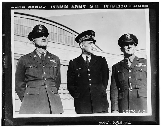 Major-General James Doolittle, United States Army Aair Forces, Major-General Bergeret of the Fighting French high command, who accepted 13 P-40 Warhawks form the Americans on behalf of the Fighting French, and Major General Carl Spaatz, United States Air Force commmander in North Africa, who made the presentation. General Spaatz is in command of Allied air forces in the North African theater of operations