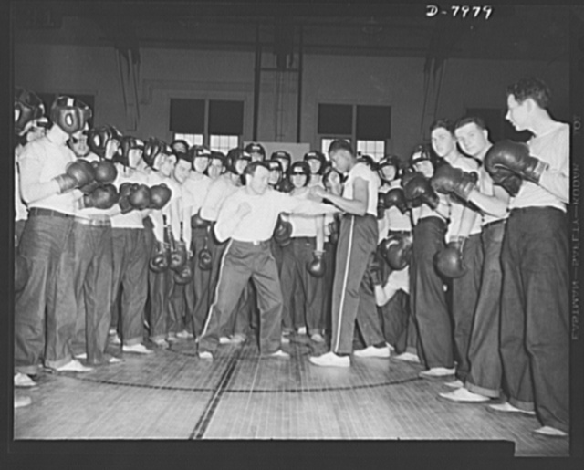 Manhattan Beach Coast Guard raining station. Boxing is compulsory in the four-week intensive course at Manhattan Beach Coast Guard training station. Lou Ambers, former world's lightweight contender, show a class of enrollees how to lead and block punches