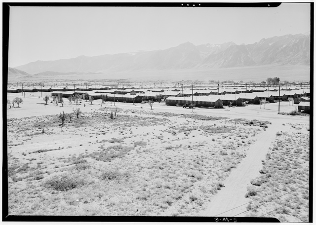 Manzanar from guard tower, summer heat, view SW, Manzanar Relocation Center / photograph by Ansel Adams.