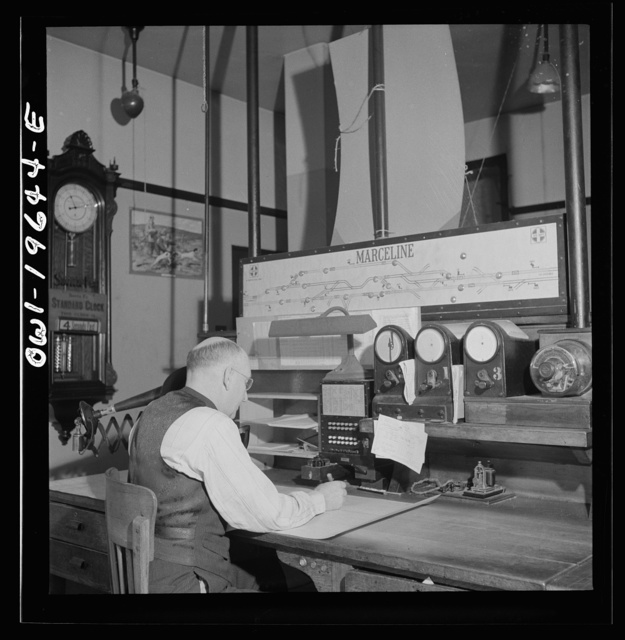 Marceline, Missouri. A dispatcher at work in the Atchison, Topeka, and Santa Fe Railroad offices