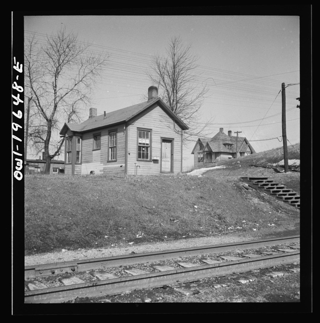 Marceline, Missouri. The switchmen's shanty at the Atchison, Topeka, and Santa Fe Railroad yard. Note the three service stars in the window