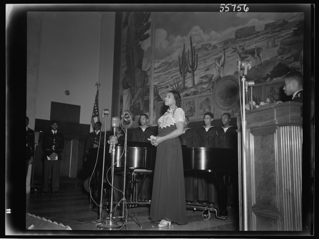 Marian Anderson at the ceremony held in the auditorium of the U.S. Department of the Interior at the dedication of a mural painting commemorating a free public concert given by her on the steps of the Lincoln Memorial on Easter Sunday, 1939