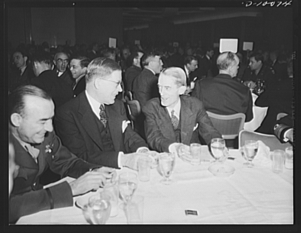 Marvin H. McIntyre (right), secretary to President Roosevelt, with fellow guests, at luncheon on second anniversary of lend-lease, March 11, 1943, at the Hotel Statler, Washington, D.C.