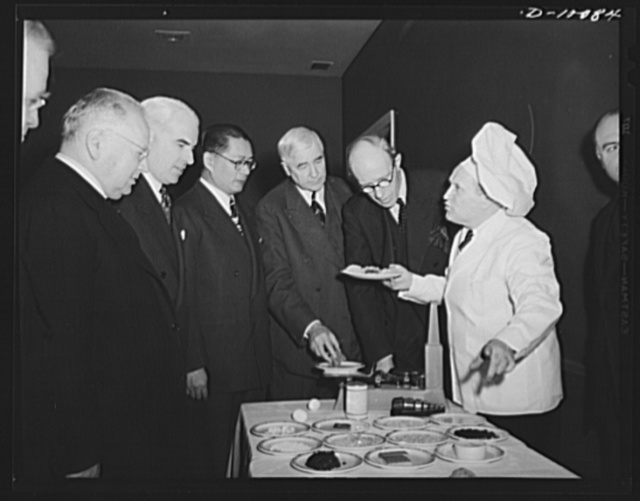 Maxim Litvinov, Russian ambassador; Edward R. Stettinius, Jr., lend-lease administrator; T.V. Soong, Chinese foreign minister; Secretary of Commerce Jesse Jones, and Lord Halifax, British ambassador, examine dehydrated food at the Hotel Statler, where a a luncheon of dehydrated food was served on March 11, 1943, to mark the second anniversary of lend-lease