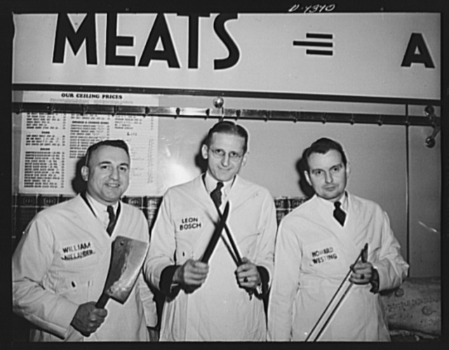 Meat rationing preview. Office of Price Administration (OPA) meat rationing executives who acted as butchers at demonstration for the press sharpen up the tools of the trade in anticipation. William Nielander, Leon Bosch, and Howard Westing with meat-cutting tools