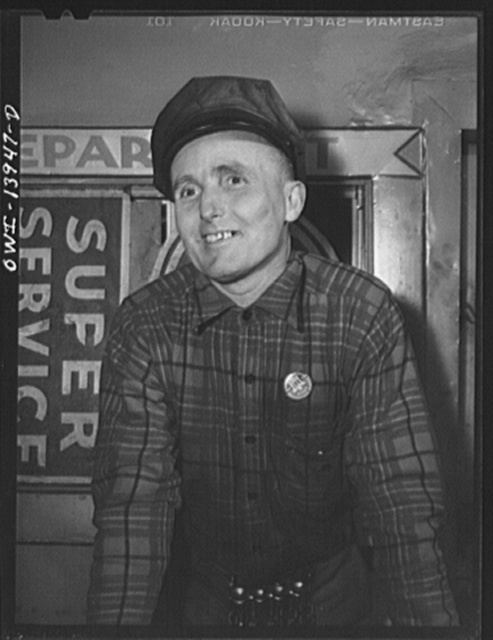 Mechanic in a New Jersey garage. Office of Defense Transportation badge means that he can travel the highways on business despite rationing
